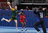Sally Cash of Australia (left,#4) rises to shoot and scores in the 5-6 placement match, between Angola and Australia.
