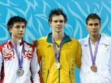 Nicholas Schafer of Australia wins the gold medal in the Youth Men's 100m Breastroke finals. On his left is silver medallist Anton Lobanov of Russia and bronze medalist Flavio Bizzarri of Italy (right).