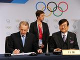 IOC President Jacques Rogge (L) signs the host city contract with bid chairman Yang Ho Cho after PyeongChang was choosen as the host city for the 2018 Olympic Winter Games during the 123rd IOC session in Durban, South Africa. PyeongChang won in the first round of voting with 63 votes, beating Munich's 25 votes and Annecy's 7 votes.