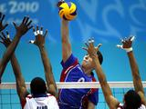 Dariel Albo (C) of Serbia spikes ball during the Boys Volleyball Semifinal match between Cuba and Serbia. Cuba won by 3-0.