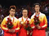 (L-R) Silver medallist Wang Hao of China, gold medallist Ma Lin of China and bronze medallist Wang Liqin of China celebrate with their medals after the Men's Table Tennis Singles Match.