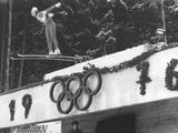 Innsbruck 1976: A view of the ski-jumping competition showing the Olympic symbol.