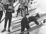 Grenoble 1968: General view of ski jumpers waxing their skis between events.