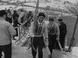 Garmisch - Partenkirchen 1936: The Swedish ski jumper Sven Eriksson makes his way to the the start of the large hill competition.