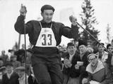 Oslo 1952: Being cheered on by the crowd, Norwegian skier Simon Slattvik crossing the finish line to take the gold medal in the 18km long distance run, combined class.