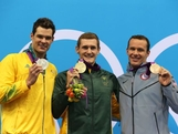 Silver medallist Christian Sprenger of Australia, gold medallist Cameron van der Burgh of South Africa and bronze medallist Brendan Hansen of the United States pose on the podium during the medal ceremony following the Men's 100m Breastsroke final on Day 2 of the London 2012 Olympic Games.