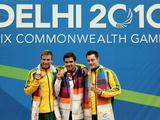 (L to R) Matthew Mitcham (silver), Alexandre Despatie (gold) of Canada and Scott Robertson (bronze) pose with the medals won in the Men's 1m Springboard Final during the Delhi 2010 Commonwealth Games.