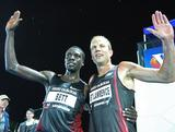 Emmanuel Bett of Kenya and Ben St Lawrence celebrate after the Zatopek: 10 Mens 10000m during the 2011 Zatopek Classic in Melbourne, Australia. Ben came in 4th place and was the first Australian to cross the line.