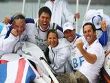 (L-R) Team GB sailing technician Peter Bentley, Andrew Simpson, RS:X windsurfer bronze medallist Bryony Shaw, Iain Percy and Finn gold medallist Ben Ainslie all of Great Britain celebrate as Percy and Simpson win gold medal in the Star class event.