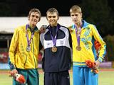 Gold medalist Isreal's Dmitry Kroytor (C), silver medalist Australia's Brandon Starc (L) and bronze medalist Urkaine's Viktor Chernysh pose for a group photo during the awarding ceremony for boys' high jump final