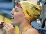 Alicia Coutts celebrates finishing the Women's 100m Freestyle Final in first place and wins the gold medal at Delhi 2010 Commonwealth Games.