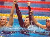 (Left to right) Michael Klim, Ian Thorpe and William Kirby of Australia celebrate gold in the men's 4x200m freestyle relay. Grant Hackett was the other team member (not pictured).