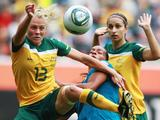 Rosana (C) of Brazil and Tameka Butt of Australia battle for the ball during the FIFA Women's World Cup 2011 Group D match between Brazil and Australia in Moenchengladbach, Germany. Brazil won the match 1-0.