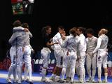 Players of Europe Team 1 and Europe Team 2 salute each other after the match during the Fencing Team Event Final. Europe Team 1 defeated Europe Team 2 by 30-24 and won the gold medal.