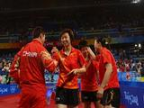 Guo Yue, Wang Nan and Zhang Yining of China celebrate after winning the gold medal in the Women's Team Gold Medal Contest table tennis event.