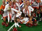 The Netherland team pose for photos after winning the gold medal in the women's hockey at the Olympic Green Hockey Field on Day 14 of the Beijing 2008 Olympic Games on August 22, 2008 in Beijing, China.