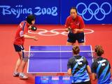 Crystal Xi Huang (top left) and Jun Gao of USA serve against Iulia Necula and Elizabeta Samara during their Women's Team Bronze Play-off Round 1 match.