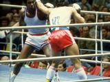 Teofilio Stevenson (left) of Cuba takes on Pawel Skrzecz of Poland in the heavyweight boxing. Stevenson went on to win the gold medal.