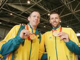 (L-R) Duncan Free and Drew Ginn pose with their Olympic gold medals as the Australian Olympic team arrive home at Sydney Airport following the Beijing 2008 Olympic Games.