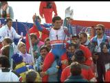 Italian Alberto Tomba being carried by happy supporters after winning the gold medal in the men's giant slalom in a time of 02:06.37.