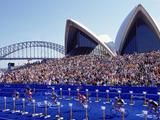 The competitors in action during the cycling leg of the Men's Triathlon at the Opera House on Day Two of the Sydney 2000 Olympic Games in Sydney, Australia.