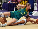 Australia's Olivia Bontempelli falling over France's Lou Mataly during the girls' preliminay basketball match between France and Australia.