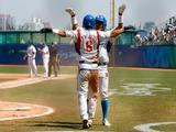 Jongwook Lee #39 and Keunwoo Jeong #8 of Korea celebrate the game tying run in the men's semifinal game against Japan at the Wukesong Baseball Field on Day 14 of the Beijing 2008 Olympic Games on August 22, 2008 in Beijing, China.