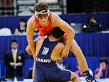 USA's Jordan Rogers (facing camera in red) fights with Turkey's Resul Kalayci during their Mens Freestyle 76 kg Gold Medal wrestling contest. Kalayci won the match 4-0.