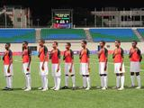 Vanuatu's football team place their hands on chest as their national anthem is played before the start of the boys' 5th-6th ranking match