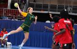 Victoria Fletcher (no.11) leaps to shoot in the 5-6 placement match between Angola and Australia. Angola won the match 39-12.