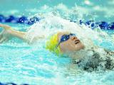 Madison Wilson of Australia swims during heat 2 of the Youth Women's 200m backstroke .