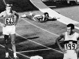 Tokyo 1964: Wilson Kipright of Kenya falls over at the finish line after coming in 7th in the men's 400 metres heat.