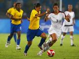Cristiane of Brazil and Shannon Boxx (#7) of United States battle for the ball during the Women's Football Gold Medal match between Brazil and the United States .