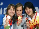 (L-R) Silver medalist Sara Isakovic of Slovenia, gold medalist Federica Pellegrini of Italy and bronze medalist Pang Jiaying of China stand on the podium during the medal ceremony for the Women's 200m Freestyle.
