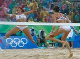 (L-R) Misty May-Treanor and Kerri Walsh of the United States celebrate winning match point against Wang Jie and Tian Jia of China in the women's beach volleyball gold medal match.