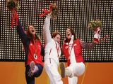 Silver medallist Shelley Rudman (R) of the Great Britain, gold medallist Maya Pedersen (C) of Switzerland and bronze medallist Mellisa Hollingsworth-Richards of Canada pose after receiving their medals during the Turin 2006 Winter Olympic Games.