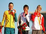 Silver medalist Jacqueline Lawrence of Australia, gold medalist Elena Kaliska of Slovakia and bronze medalist Violetta Oblinger Peters of Austria celebrate on the podium after the Women's Kayak (K1) Finals event at the Shunyi Olympic Rowing-Canoeing Park.