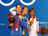 (L-R) Silver medalist Ana Maria Branza of Romania and gold medalist Britta Heidemann of Germany joke around as bronze medalist Ildiko Mincza-Nebald of Hungary stands on the podium after receiving their medals in the Women's Individual Epee .