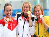 (L-R) Bronze medalist Natalie Coughlin of the United States, gold medalist Britta Steffen of Germany and silver medalist Lisbeth Trickett of Australia pose during the medal ceremony for the Women's 100m Freestyle Final.