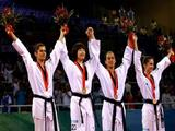 (L-R) Silver medalist Azize Tanrikulu of Turkey, gold medalist Lim Sujeong of South Korea and bronze medalists Diana Lopez of the United States and Martina Zubcic of Croatia wave to the crowd during the medal ceremony of the Women -57kg contest.