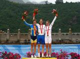 (L-R) Silver medalist Emma Johansson of Sweden, gold medalist Nicole Cooke of Great Britain and bronze medalist Tatiana Guderzo of Italy pose on the podium during the medal ceremony for the women's road cycling event.