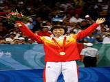 Zhang Yining of China receives the gold medal during the medal ceremony for the Women's Singles Table Tennis Final.