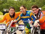 Kirsten Dellar of Australia the silver medallist, Mayara Perez of Brazil the gold medallist and Maartje Hereijgerse of the Netherlands the bronze medallist celebrate after the Junior Women's BMX final