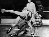 London 1948: Egyptian featherweight wrestler Seyid M Kandil (right) with Dutch wrestler H Dijk during a bout. Seyid M Kandil was placed sixth in the final.