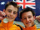Scott Robertson and Matthew Mitcham with their gold medals after winning the Boy's 3 Metre Synchronised diving event durin the 2005 Australian Youth Olympic Festival in Sydney.