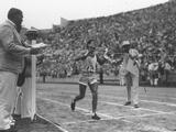 Los Angeles 1932: Juan Carlos Zabala of Argentina approaches the finishing tape to win the marathon event.