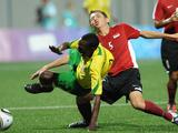 Zimbabwe's Sibanda Pritchard (centre in yellow) tackles Singapore's Jeffrey Lightfoot for the ball in the Singapore versus Zimbabwe boys' preliminary football match. Singapore won 3-1.